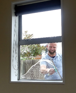 Window Cleaning with Sqeegee and Mop